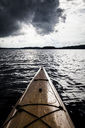 Cropped image of kayak on lake against cloudy sky at dusk - MASF04373
