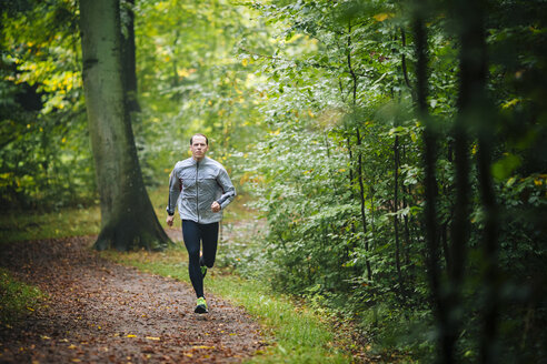 Full length of man jogging in forest - MASF04397
