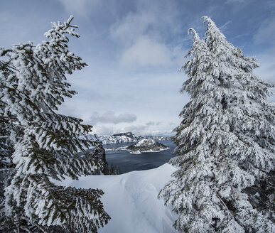 High angle view of Wizard Island amidst lake at Crater Lake National Park - CAVF38728
