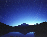 Majestic view of Trillium Lake by Mt Hood against star trails - CAVF38770