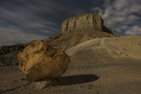 Low angle scenic view of rock formation against cloudy sky at Grand Staircase-Escalante National Monument during night - CAVF38773