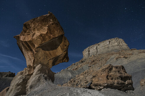 Low angle view of rock formations against star field at Grand Staircase-Escalante National Monument - CAVF38776