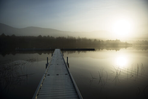 Pier over lake against sky at sunrise - CAVF38881