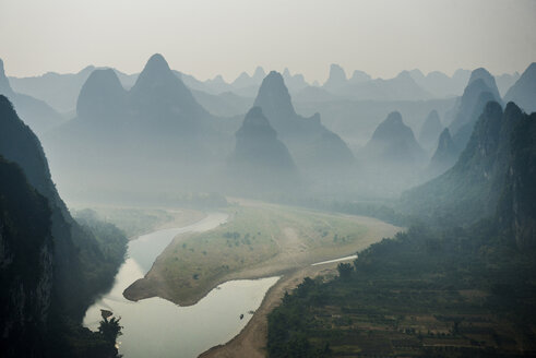 River flowing against mountain during foggy weather - CAVF39049