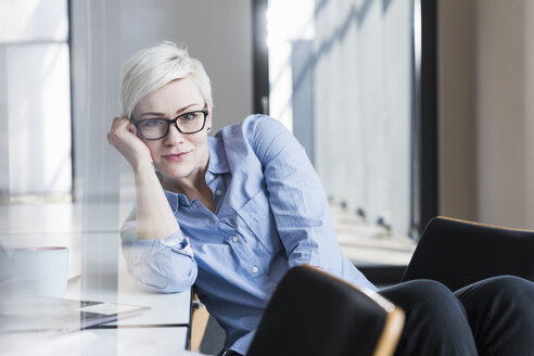 Portrait of confident woman in office - UUF13354