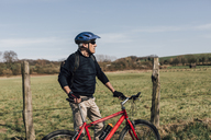 Mountainbiker with cycling helmet - GUSF00634