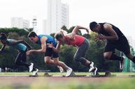 Athletes running from starting blocks on track - CAVF39862