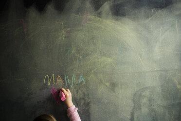 Cropped image of girl drawing on blackboard - CAVF40084