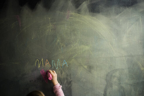Cropped image of girl drawing on blackboard - CAVF40084