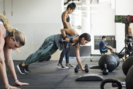 Female athletes doing crossfit training in crossfit gym - CAVF40264