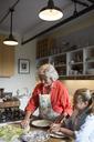 Happy family preparing food in kitchen - CAVF40483