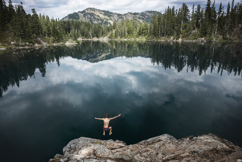 High angle view of hiker diving in lake against forest at Mt. Rainier National Park - CAVF40684
