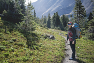 Woman hiking on pathway in mountain - CAVF41403