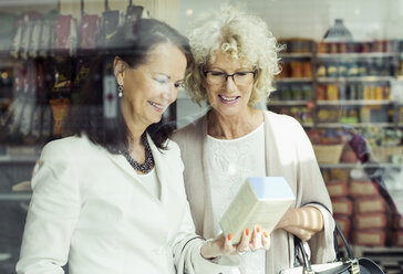 Senior women checking instructions on product in store - MASF04747