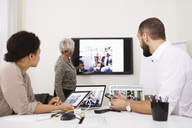Side view of businesswoman giving presentation to colleagues in office - MASF04804