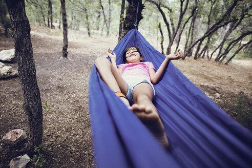 Girl lying on hammock in forest - CAVF41725