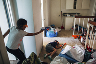 High angle view of friends playing with toy guns at home - CAVF41854