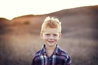Portrait of smiling boy at field on sunny day - CAVF42084