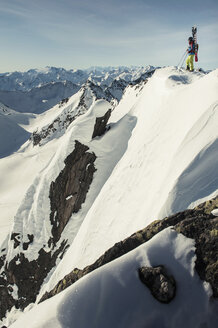 Low angle view of skier standing on snowcapped mountain - MASF04884