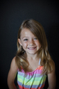 Portrait of happy girl standing against wall at home - CAVF42368