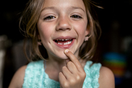 Portrait of girl showing gap tooth - CAVF42377