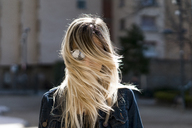 Portrait of young woman with blowing hair - AFVF00441