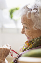 Happy senior woman looking away at nursing home - MASF04948