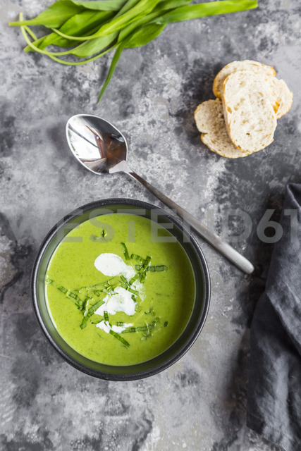 Bowl of ramson soup garnished with ramson and cream - SARF03667
