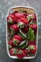 Directly above shot of strawberries in container on table - MASF05082