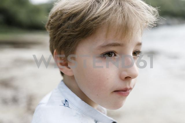 Portrait of blond boy watching something - KMKF00157