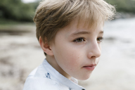 Portrait of blond boy watching something - KMKF00157