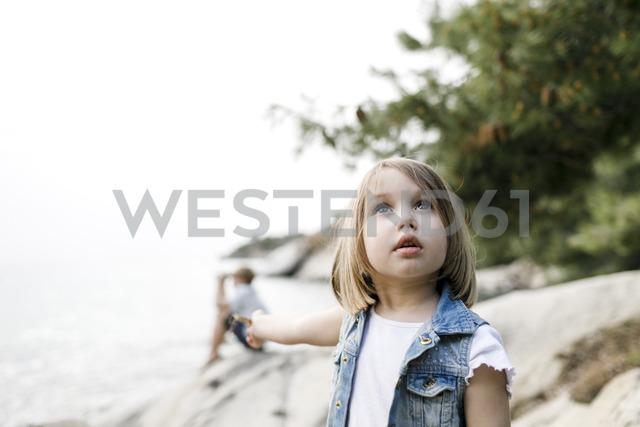 Portrait of little girl looking up - KMKF00169