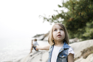 Portrait of little girl looking up - KMKF00169