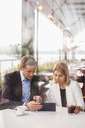 Business people using digital tablet in cafe - MASF05142