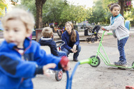 Angry teacher with children playing on playground - MASF05154