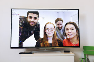 Business people on screen in video conference room at creative office - MASF05160