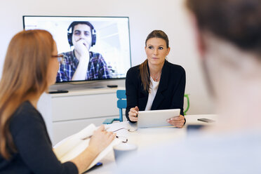 Creative business people discussing during video conference in office - MASF05214