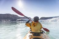 Rear view of mature woman kayaking on sea - MASF05250