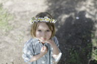 Portrait of blond little girl wearing flowers - KMKF00177