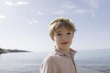 Portrait of boy wearing flowers - KMKF00180