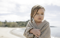 Portrait of sad little girl wrapped in cardigan - KMKF00186