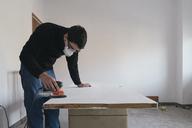 Man sanding door - SKCF00436
