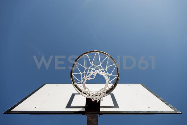 Basketball hoop against blue sky - FMOF00333