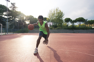 Young man playing basketball - FMOF00351