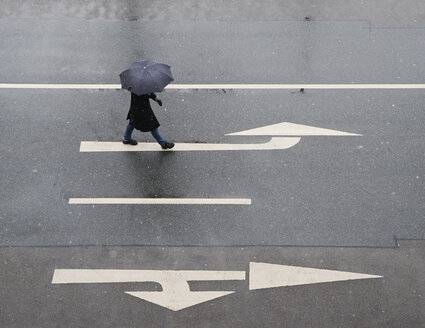 High angle view of woman with umbrella walking on road - MASF05598