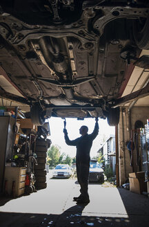 Full length of mechanic working in auto repair shop - MASF05636