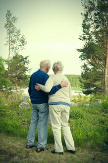 Full length rear view of senior couple looking at lake - MASF05657