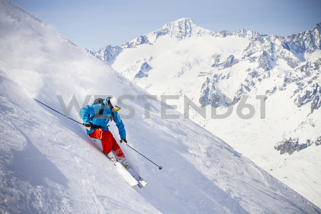 Full length of man skiing on mountain slope - MASF05672