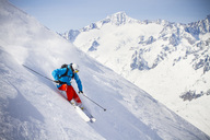 Full length of man skiing on mountain slope - MASF05672