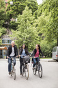 Business people riding bicycles on street - MASF05726